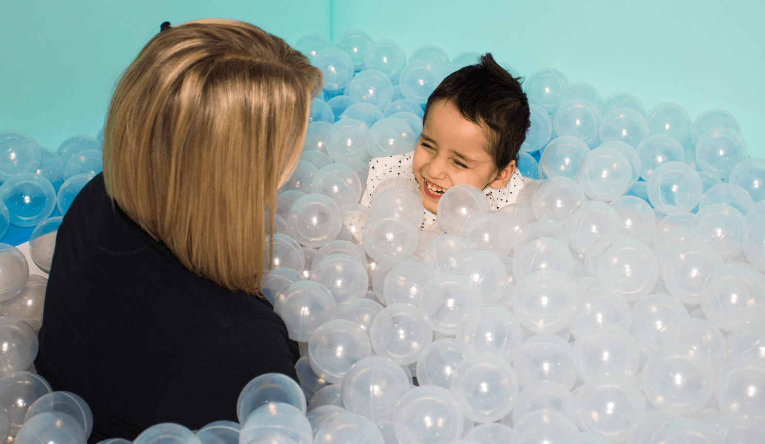 Child plays in ball pit