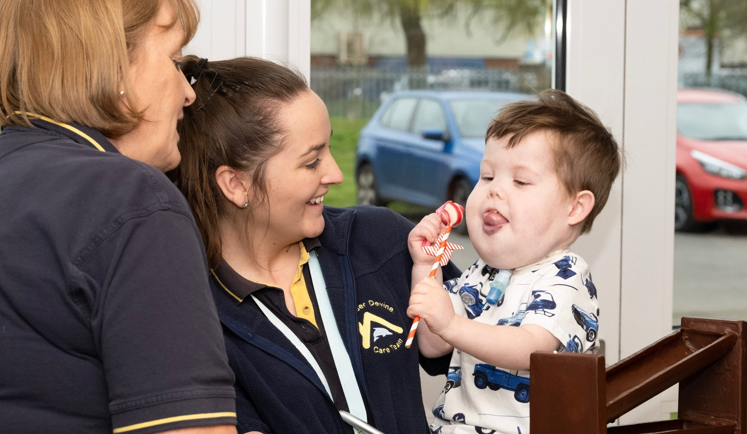Alexander Devine care team with little boy.