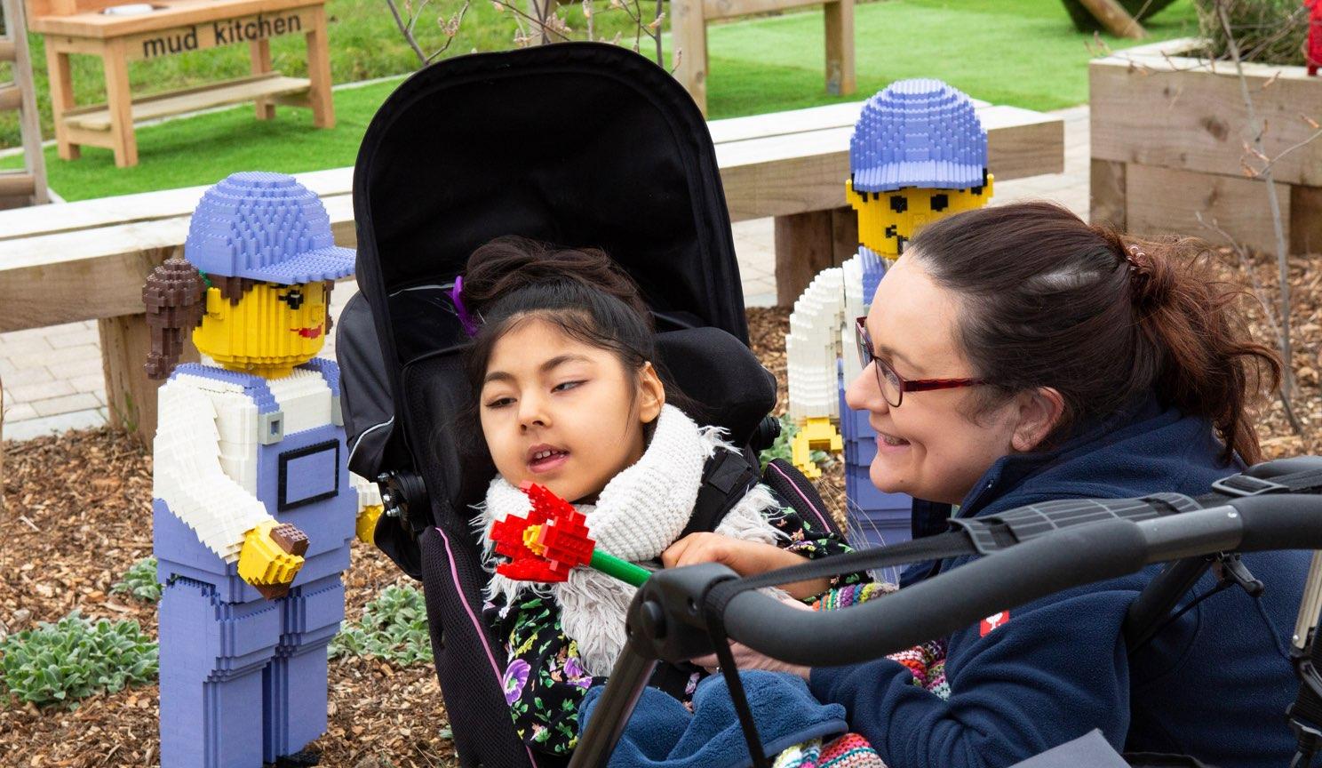 Alexander Devine Children in Gardens with Lego figures.